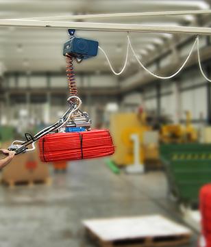 Préhension de bobines de câble par serrage interne