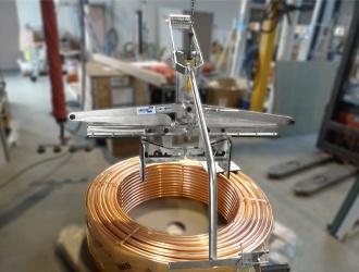 Pinces pantographes pour bobine de câble