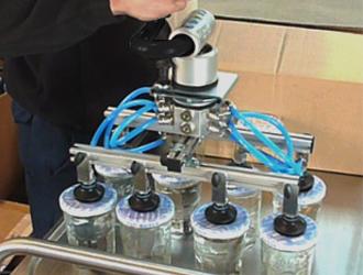 Palonnier à ventouses pour bocaux en verre
